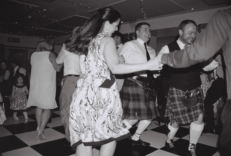 People dancing a Scottish ceilidh at a pub in Glasgow