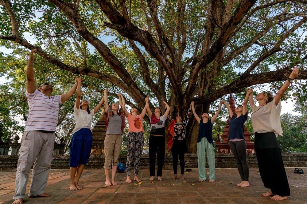 Spiritual group in Angkor Wat in a yoga retreat