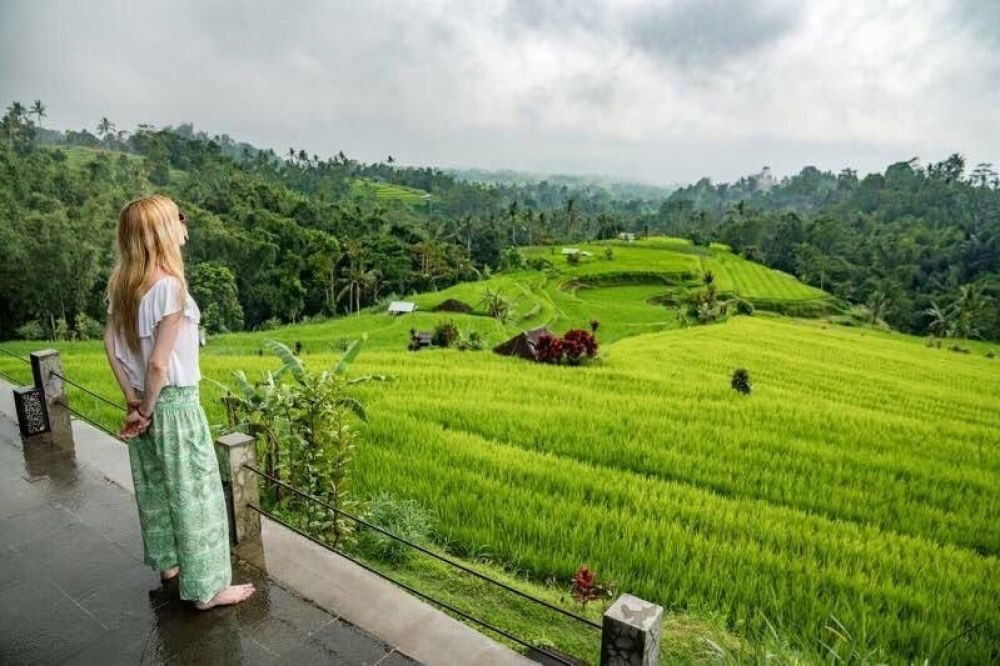 Backpacker watching a rice field in Bali, Indonesia