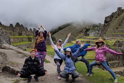 Group of yogis on an affordable yoga retreat in Machu Picchu Peru