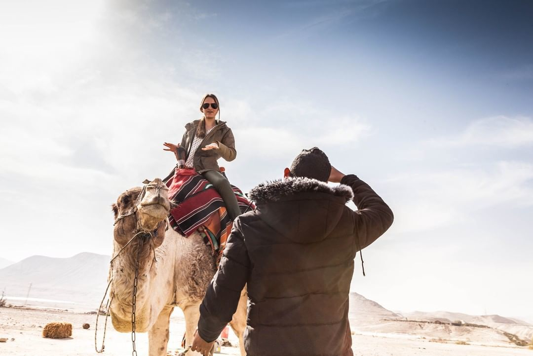 Woman on a camel with one of the best tour companies in Israel