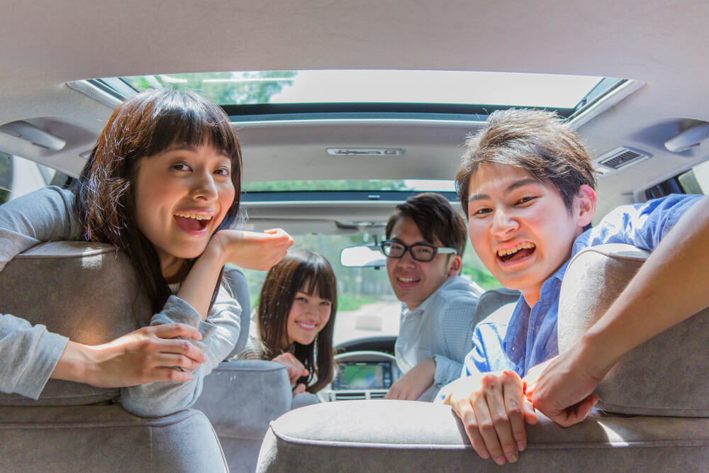 A group of students on a road trip in Japan driving safe