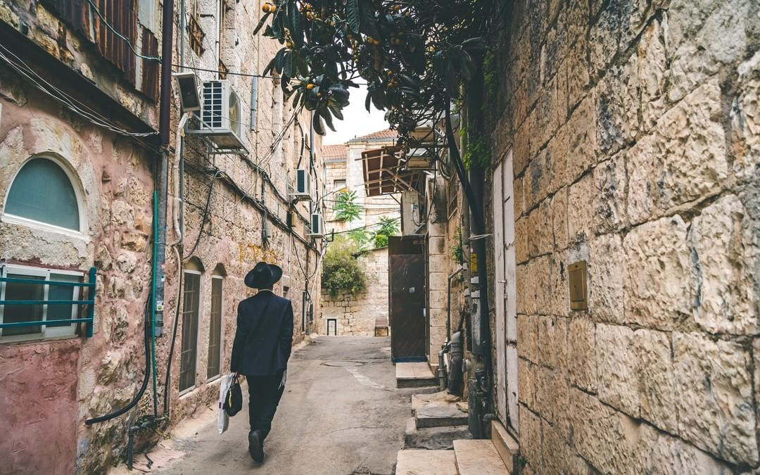 An Ultra-Orthodox Jew walking in Jerusalem