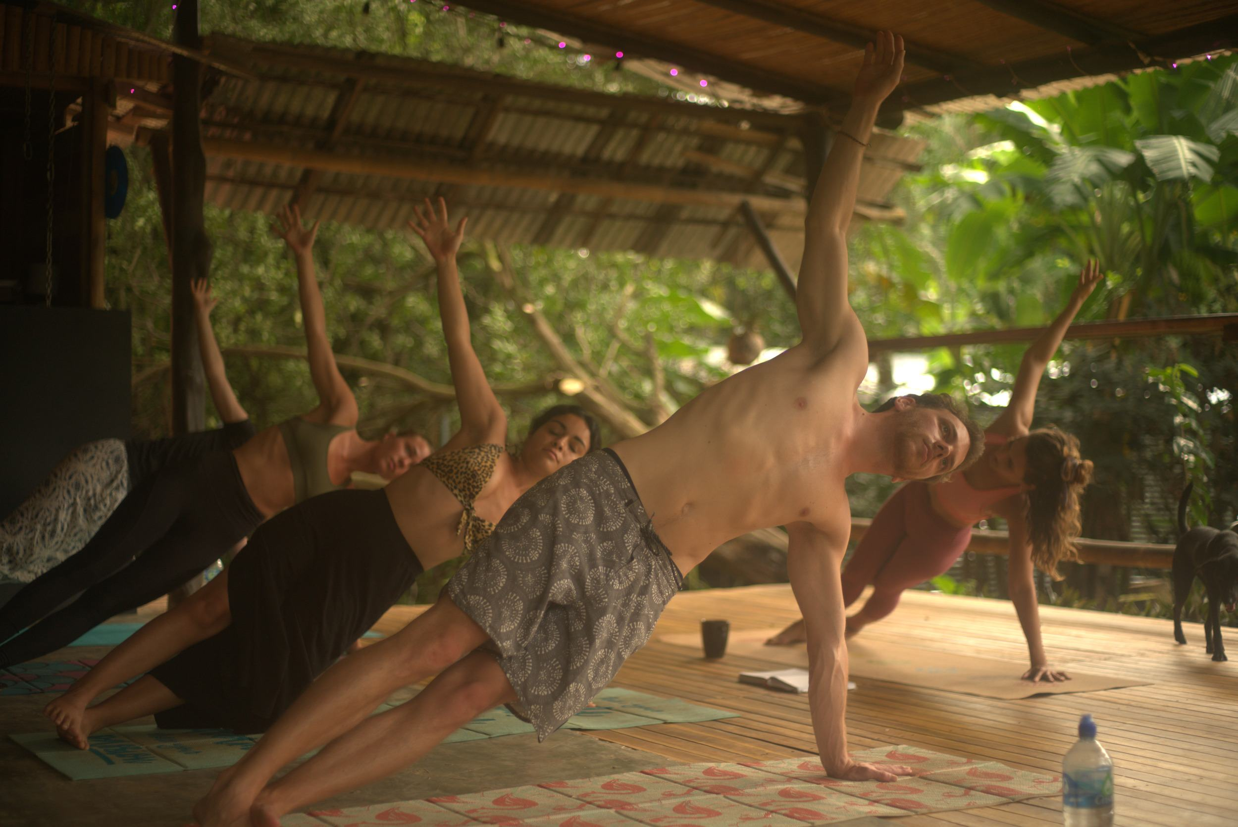 Some students in a hostel doing yoga
