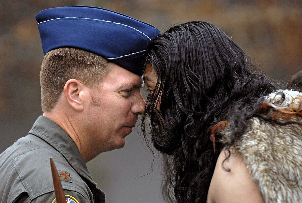 A Maori person and a soldier performing the hongi