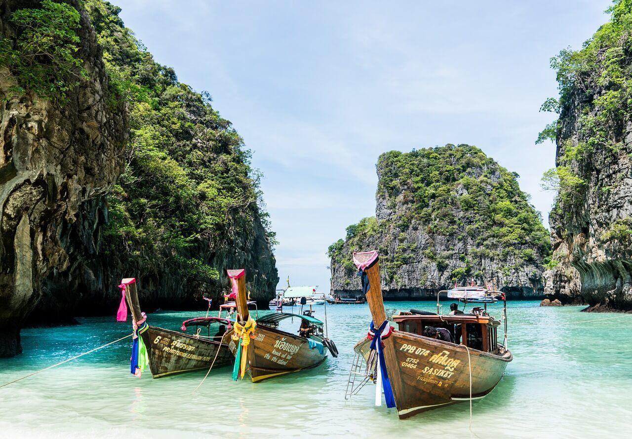 Longboats at a tropical beach in Phuket, Thailand