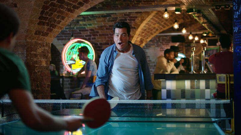 Man playing table tennis enjoying the hostel life