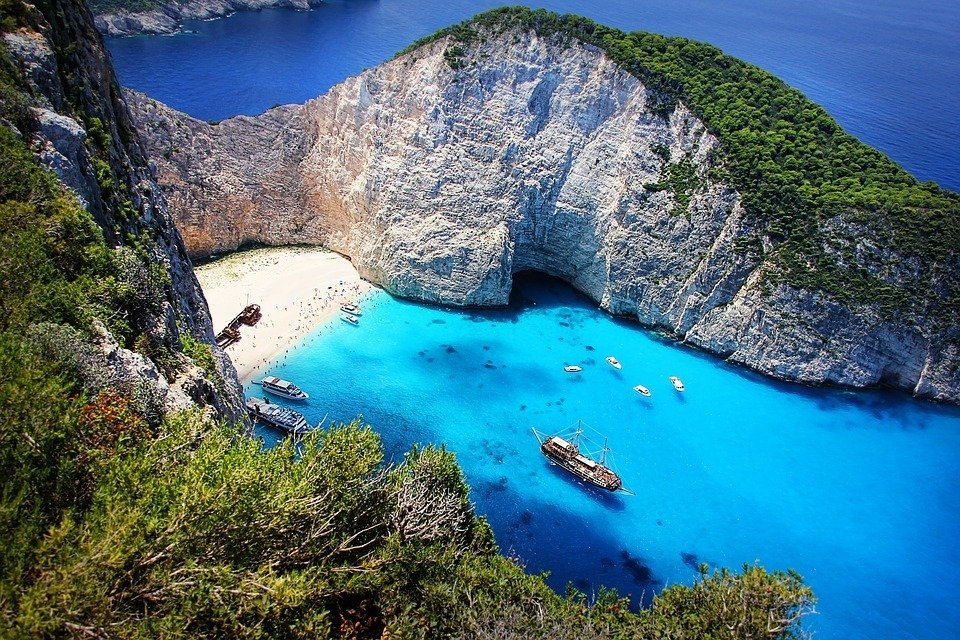A beautiful Greek Island with a shipwreck on a tourist beach
