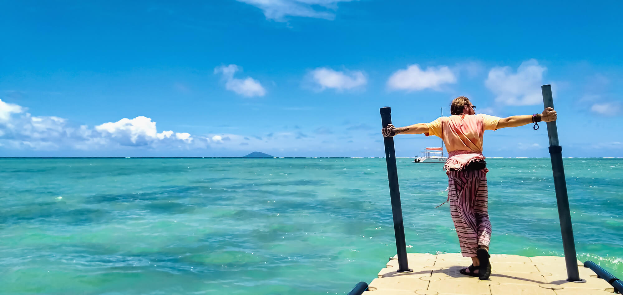 Man poses basically on one of the most beautiful beaches in Mauritius