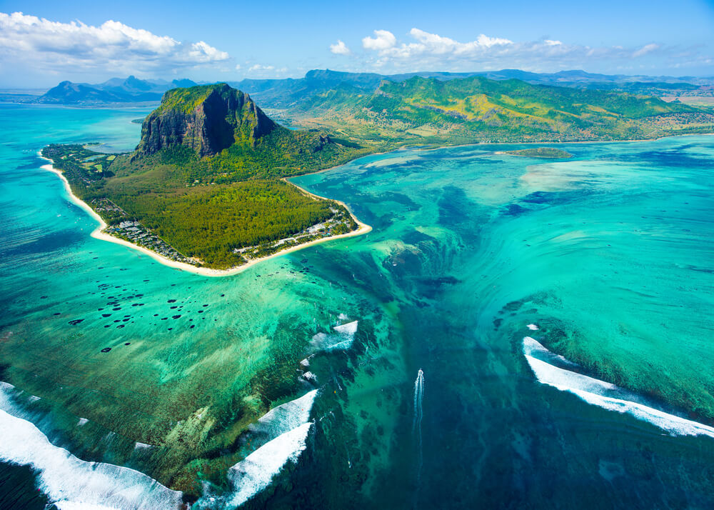 The optical illusion underwater waterfall in Mauritius from a helicopter tour