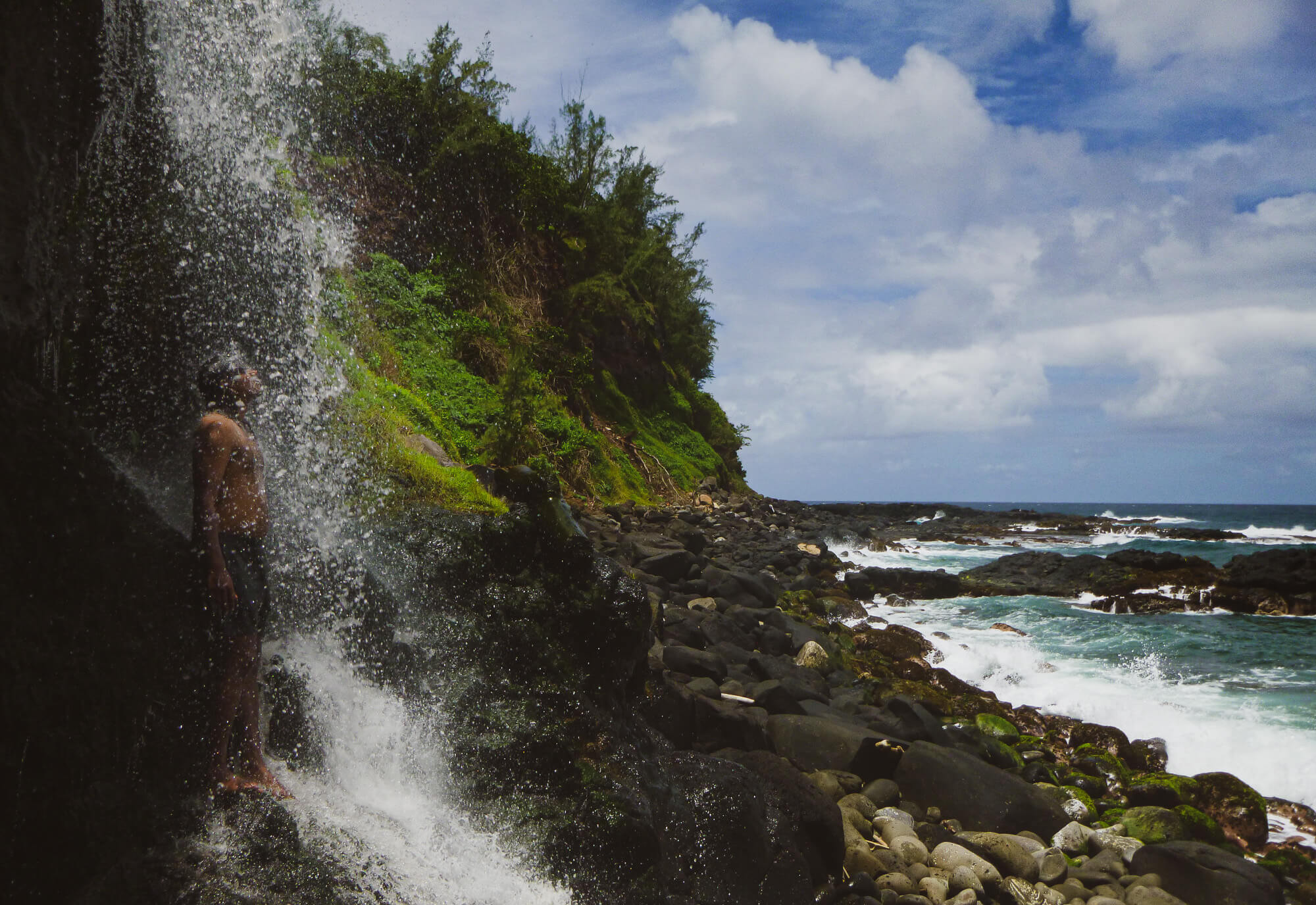 Waterfall while hiking on Mauritius's south coast wild beaches