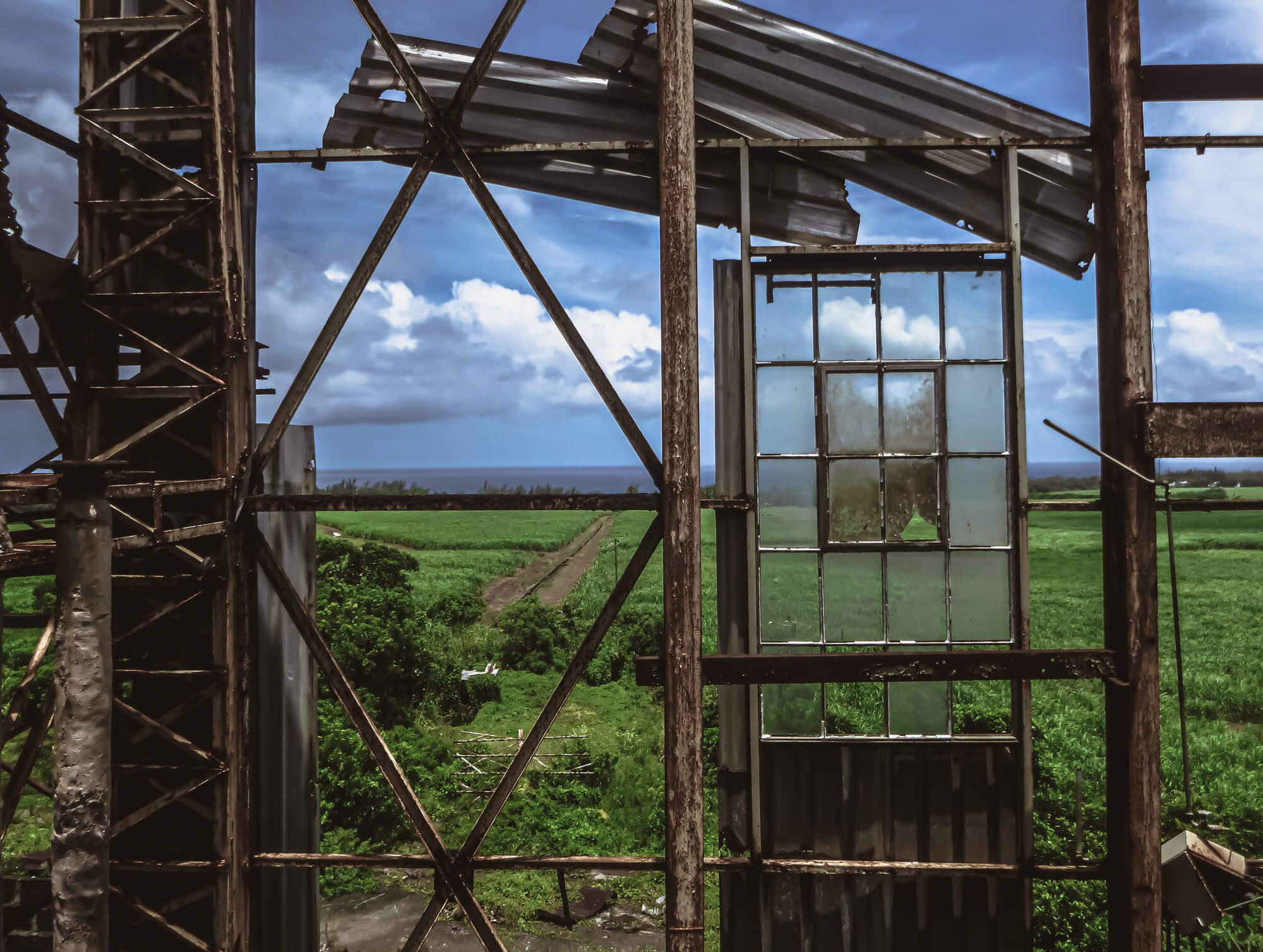 Climbing a rusty factory of questionable safety in Mauritius