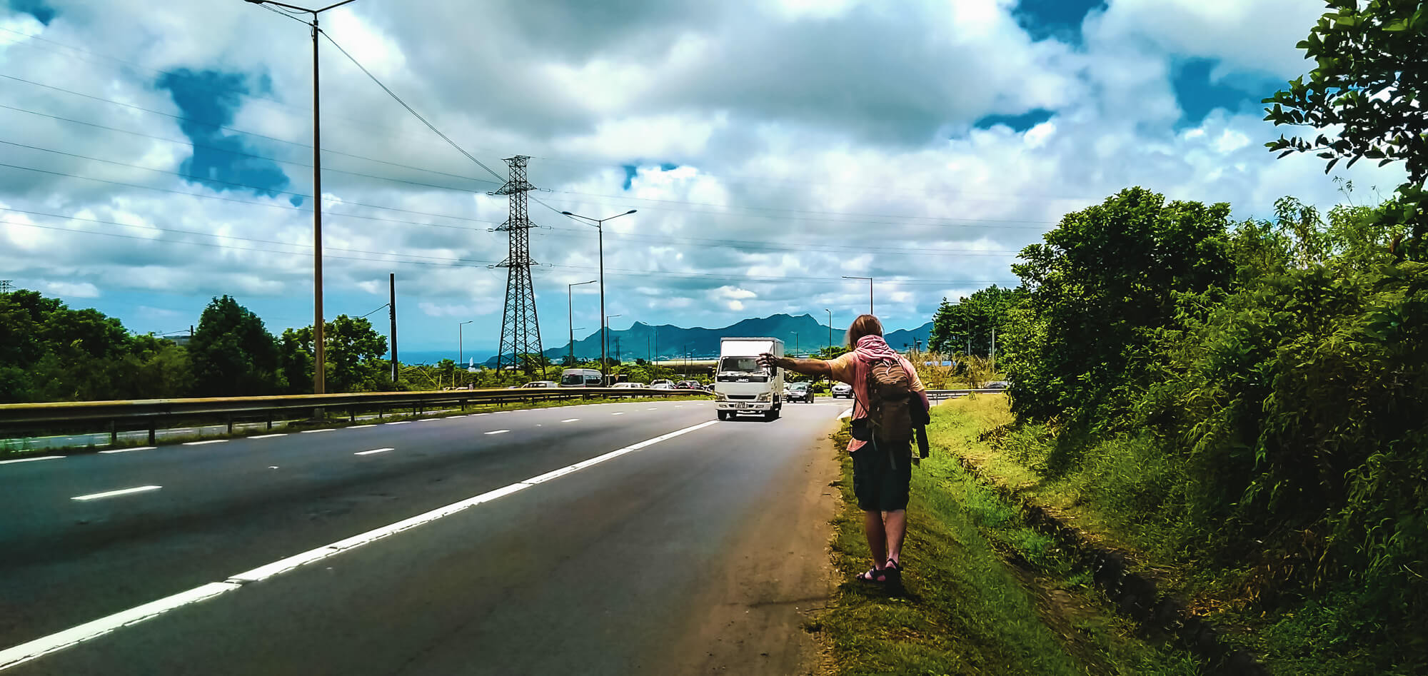 A traveller in Mauritius hitchhikes to reduce his trip cost