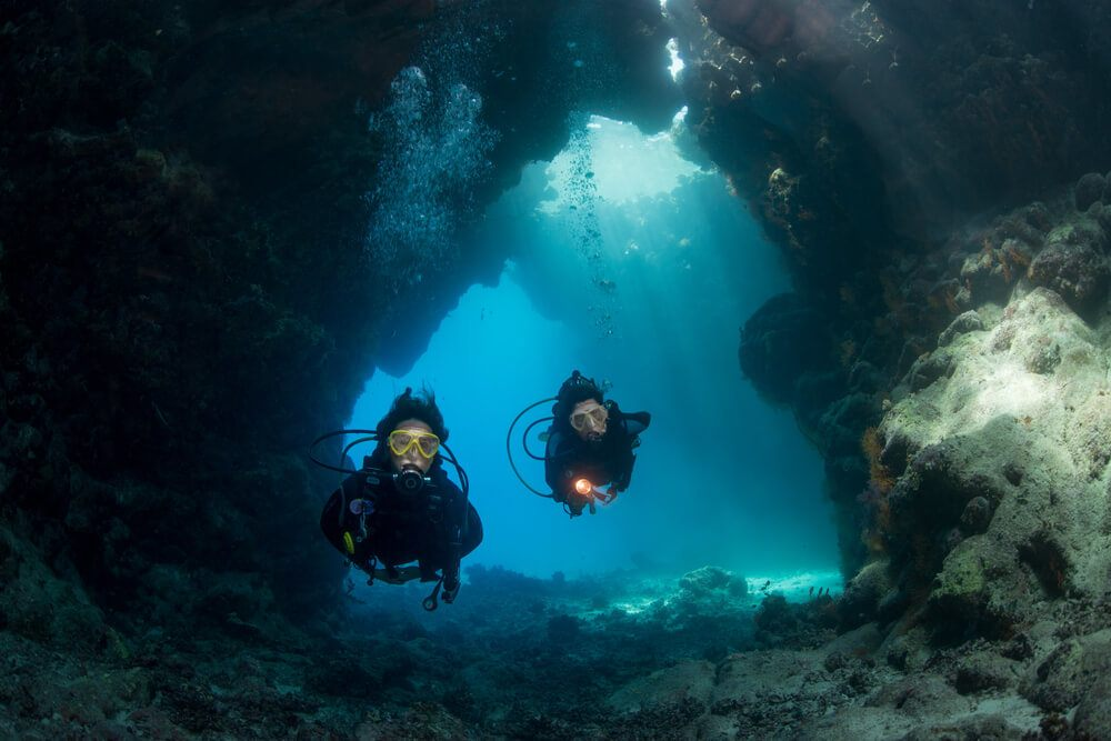 Beginner divers in a cave while taking an Eilat diving course