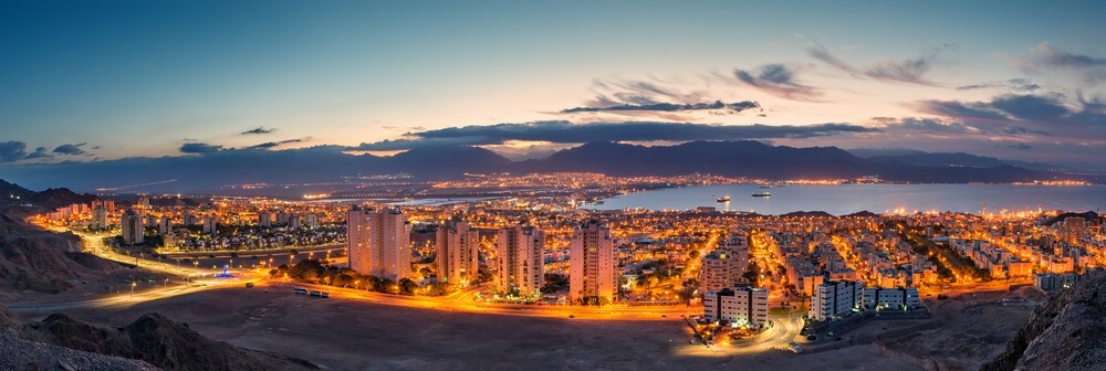 Aerial photo of Eilat's city lights and the Red Sea