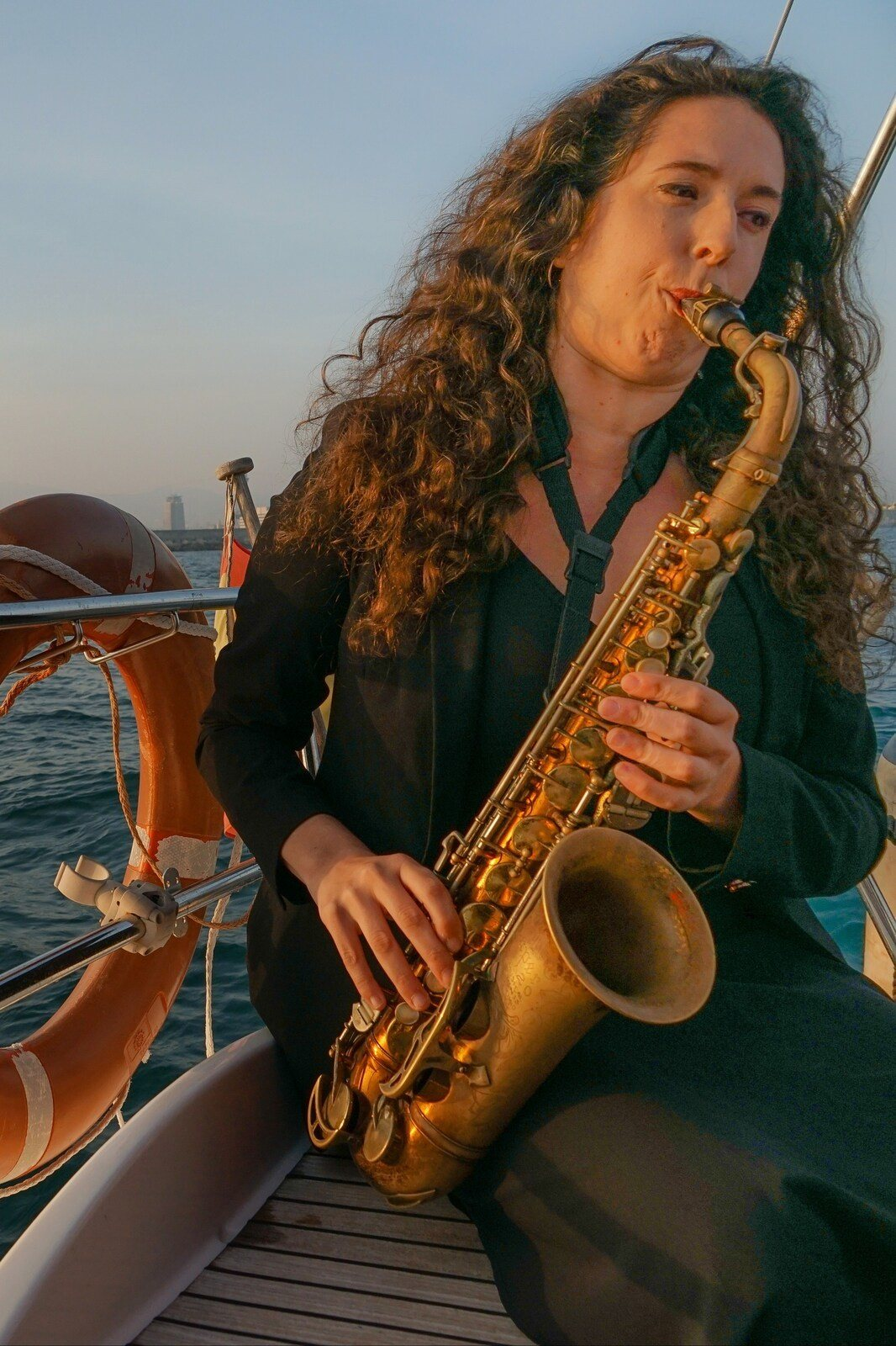 Experience Live Sax and Sunset Sailing