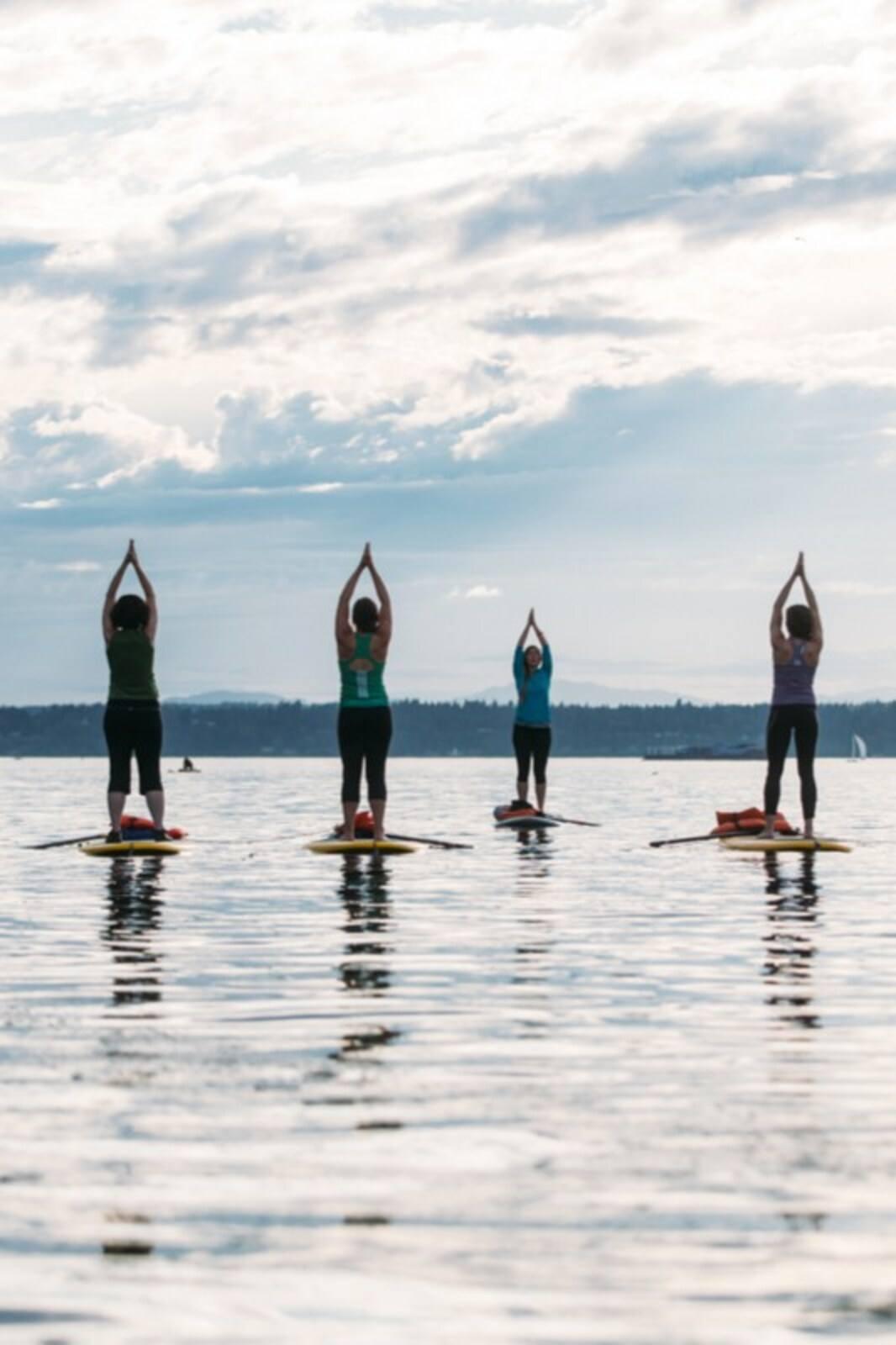 Join a SUP Yoga Detox Flow Class
