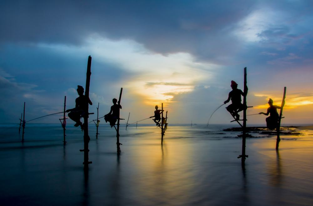 Photographing the famous stilt fishermen while on a tour of the south Sri Lanka coast
