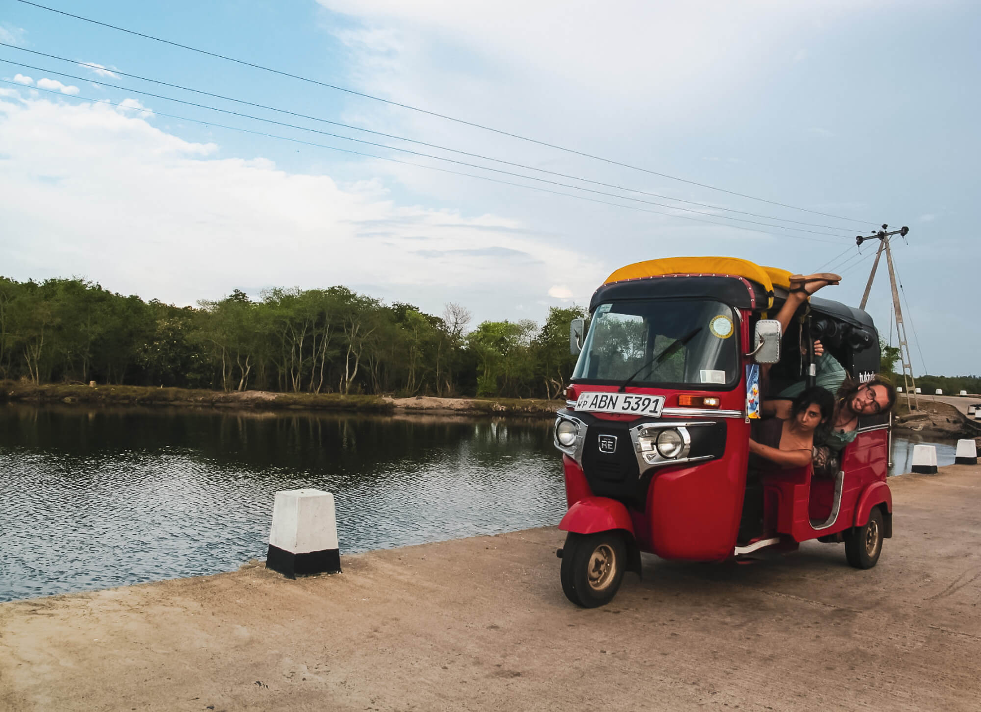 Two backpackers in their tuk-tuk rental in Sri Lanka - the best way to travel