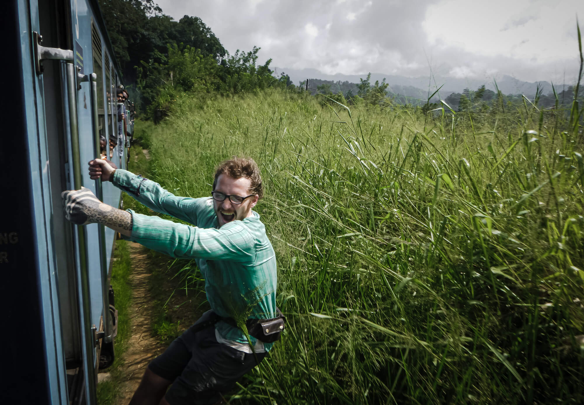 A backpacker riding the Kandy to Ella train in Si Lank