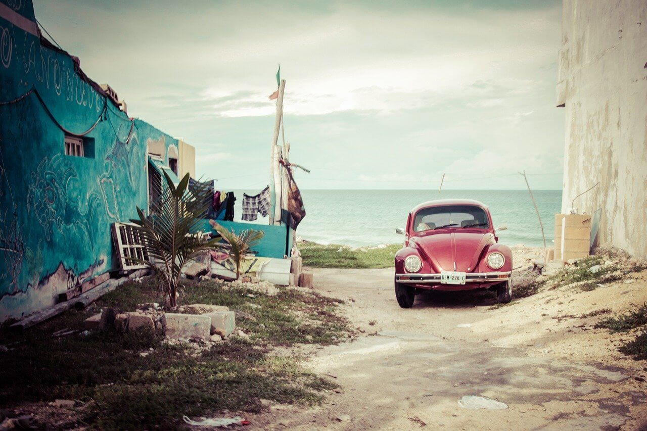 A car by te beach in Quintana Roo - a state in Mexico recently reopened after COVID travel bans