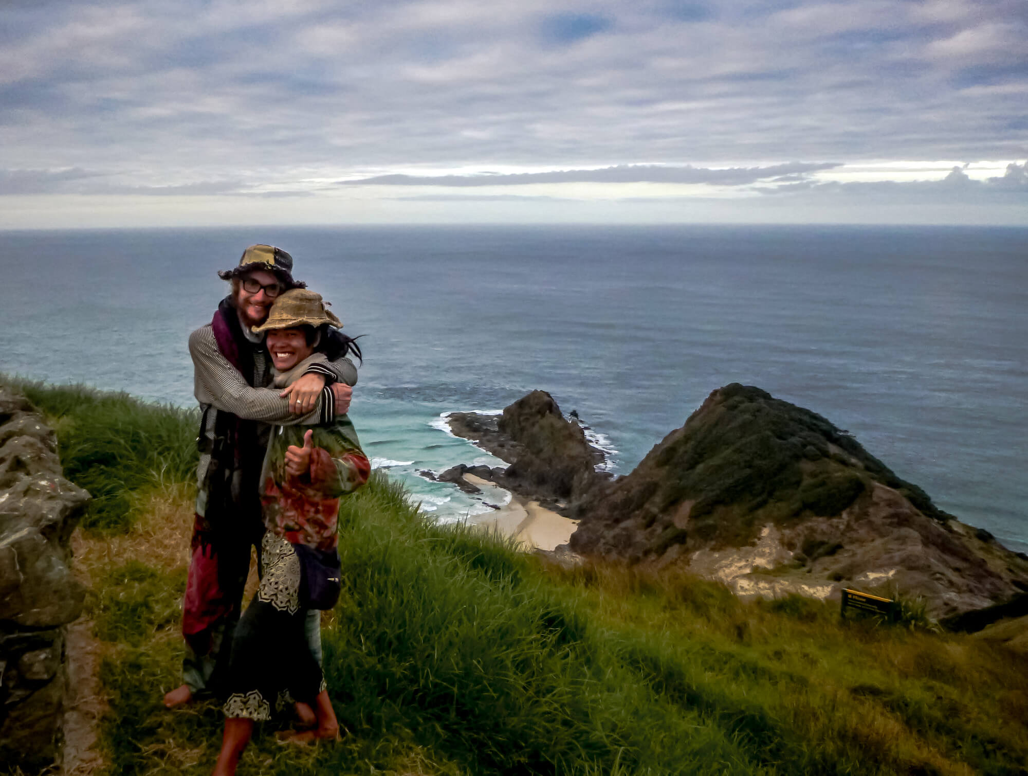 Cape Reinga, New Zealand - me and my first travel companion