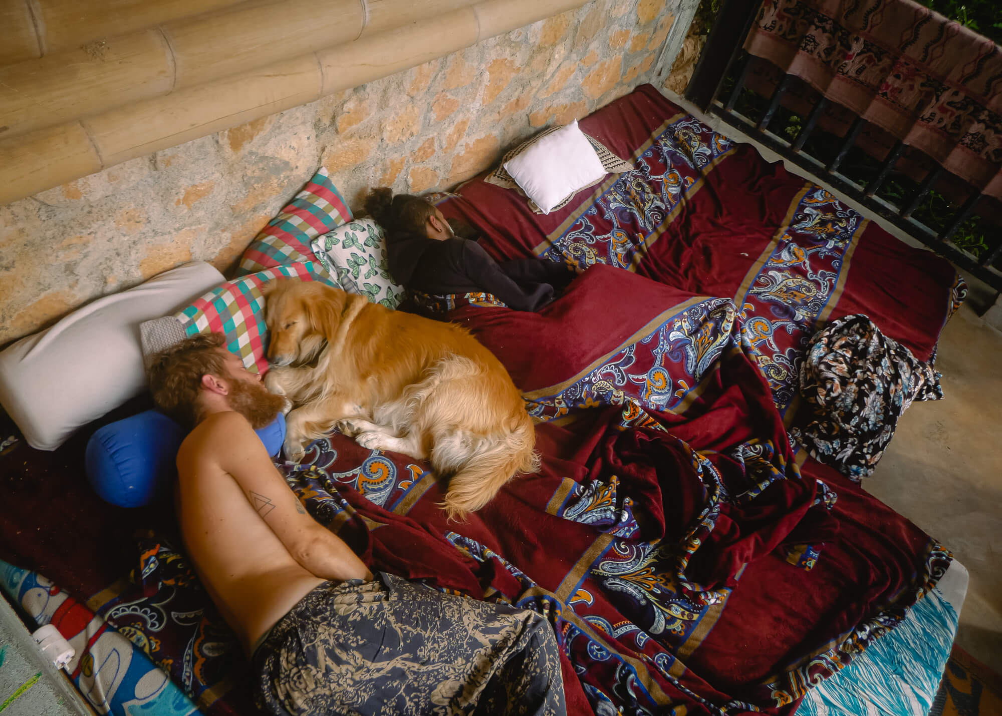 The queen of the best hostel in Sri Lanka asleep with her king