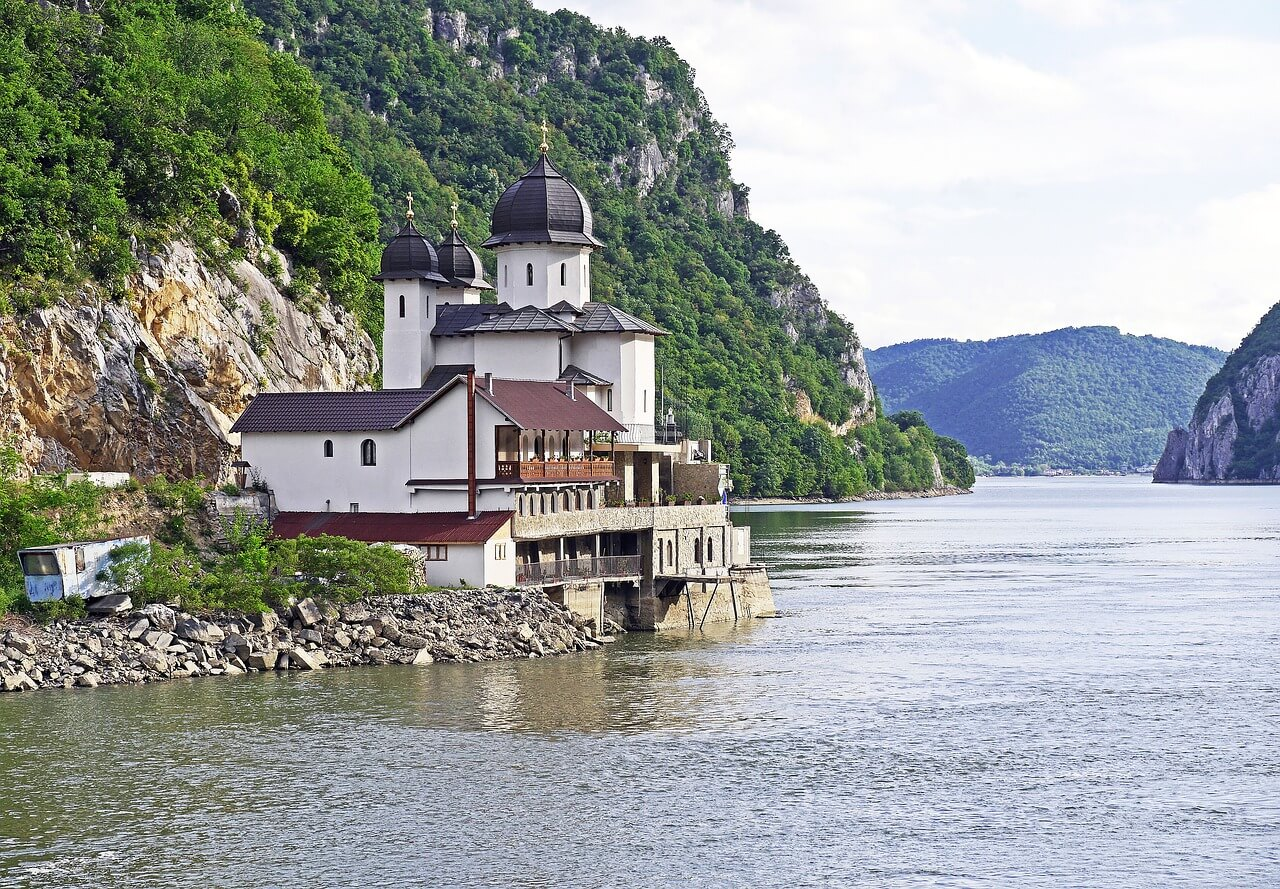 Church in Serbia by a calm river