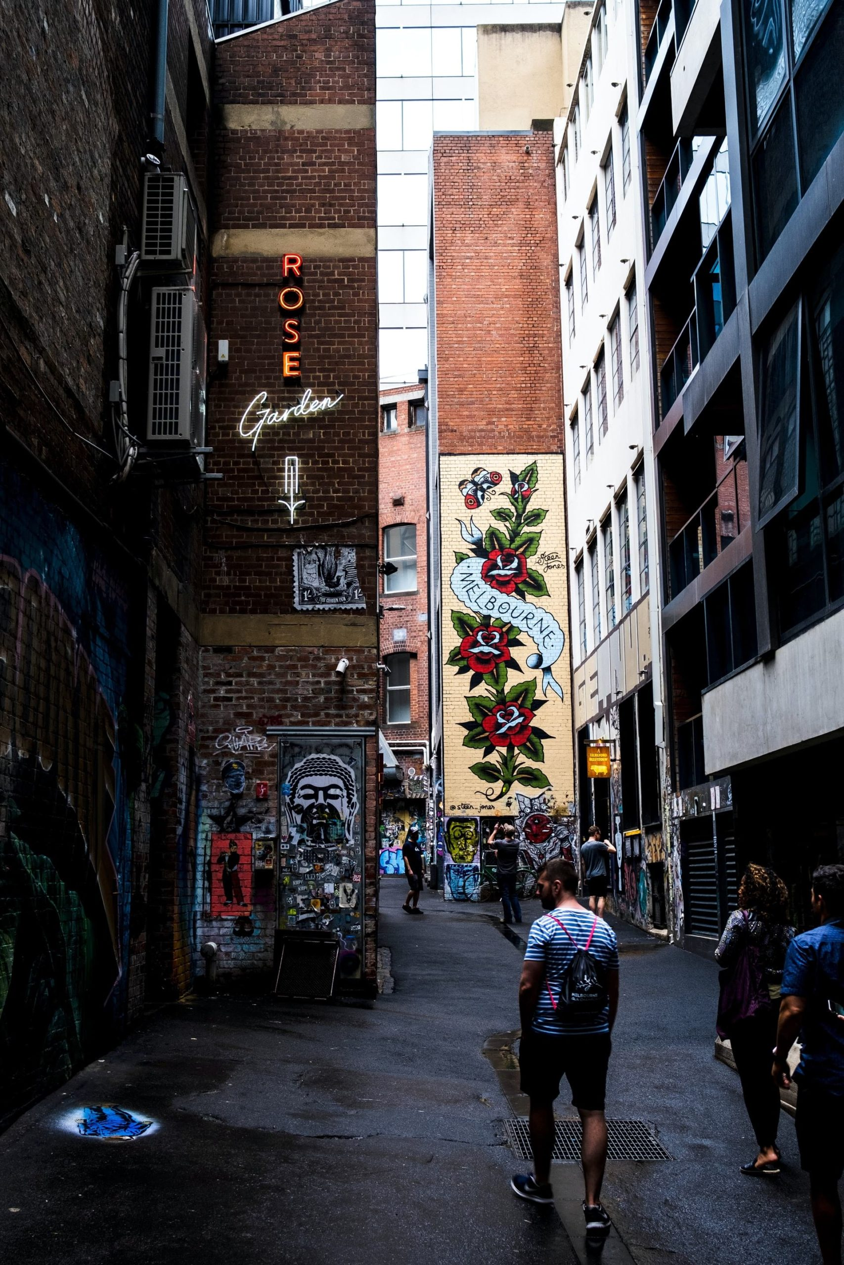 Famous laneway in Melbourne filled with Australians enjoying recreational activities