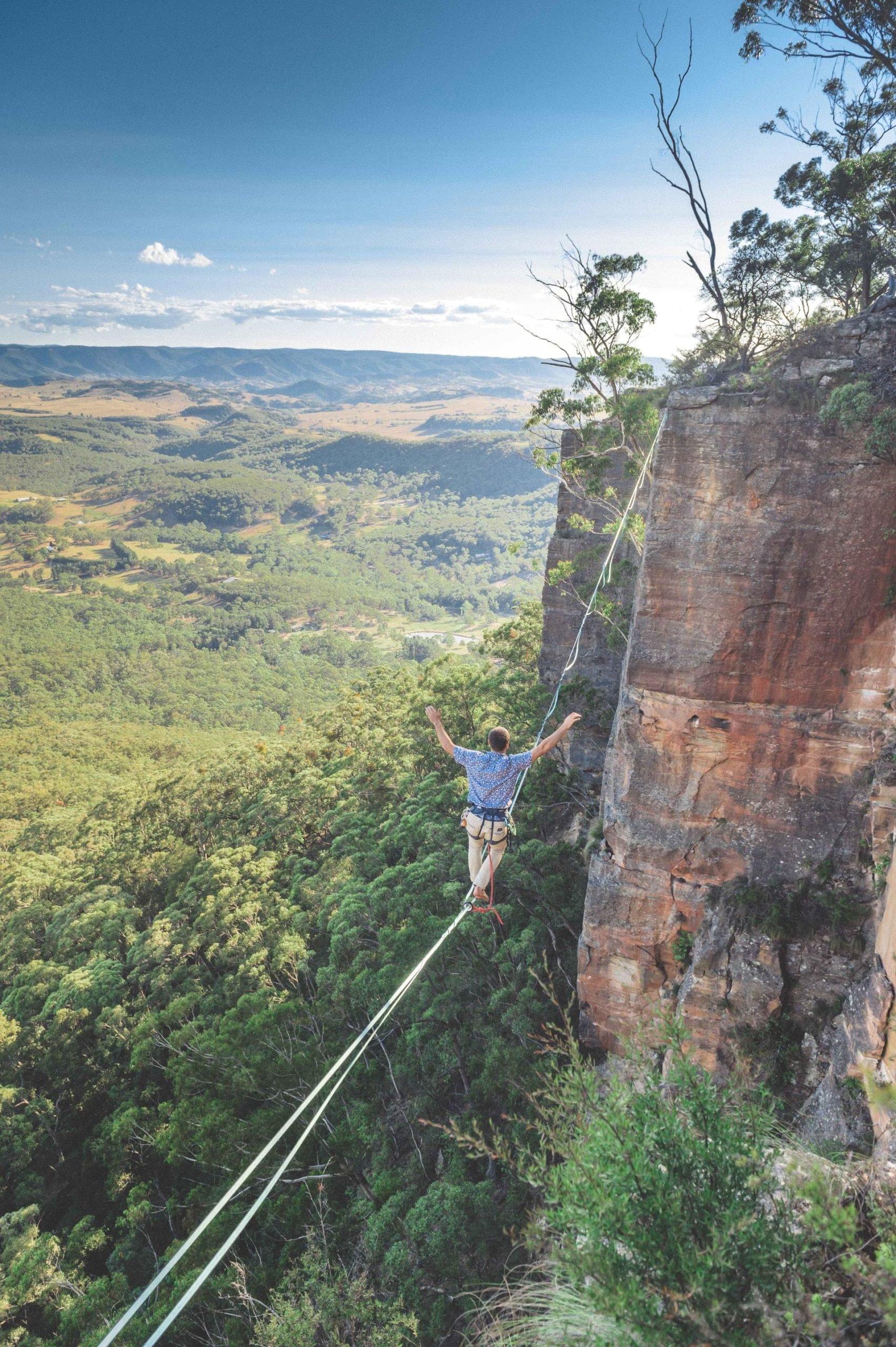 An Australian adventurer highlining in the Blue Mountains