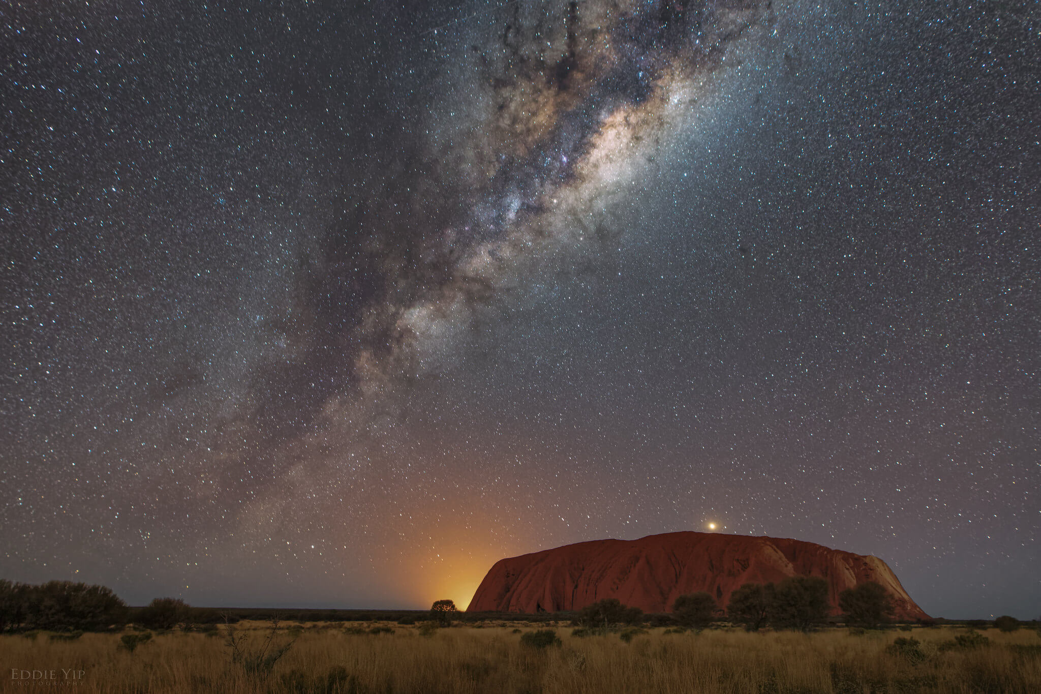 Uluru (Ayers Rock) under a starry sky - most famous national park in Australia