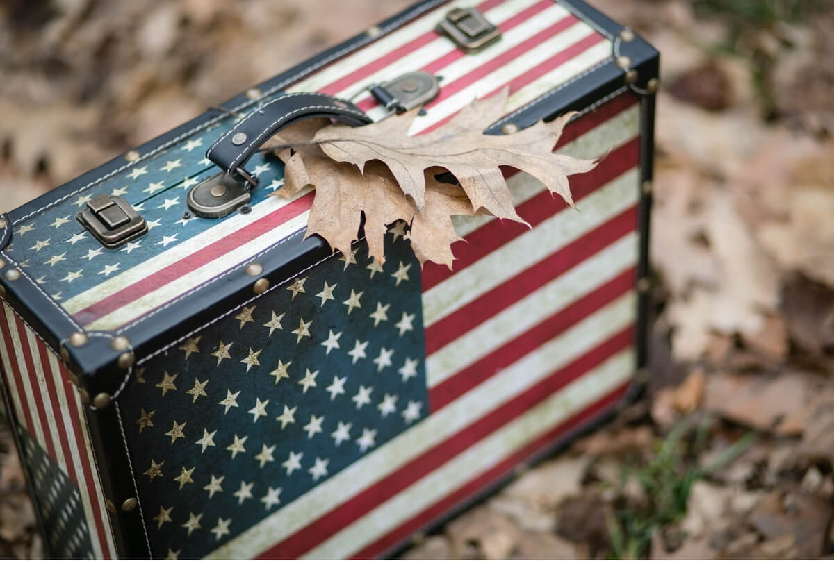 American flag-style suitcase packed for a country that is accepting US citizens