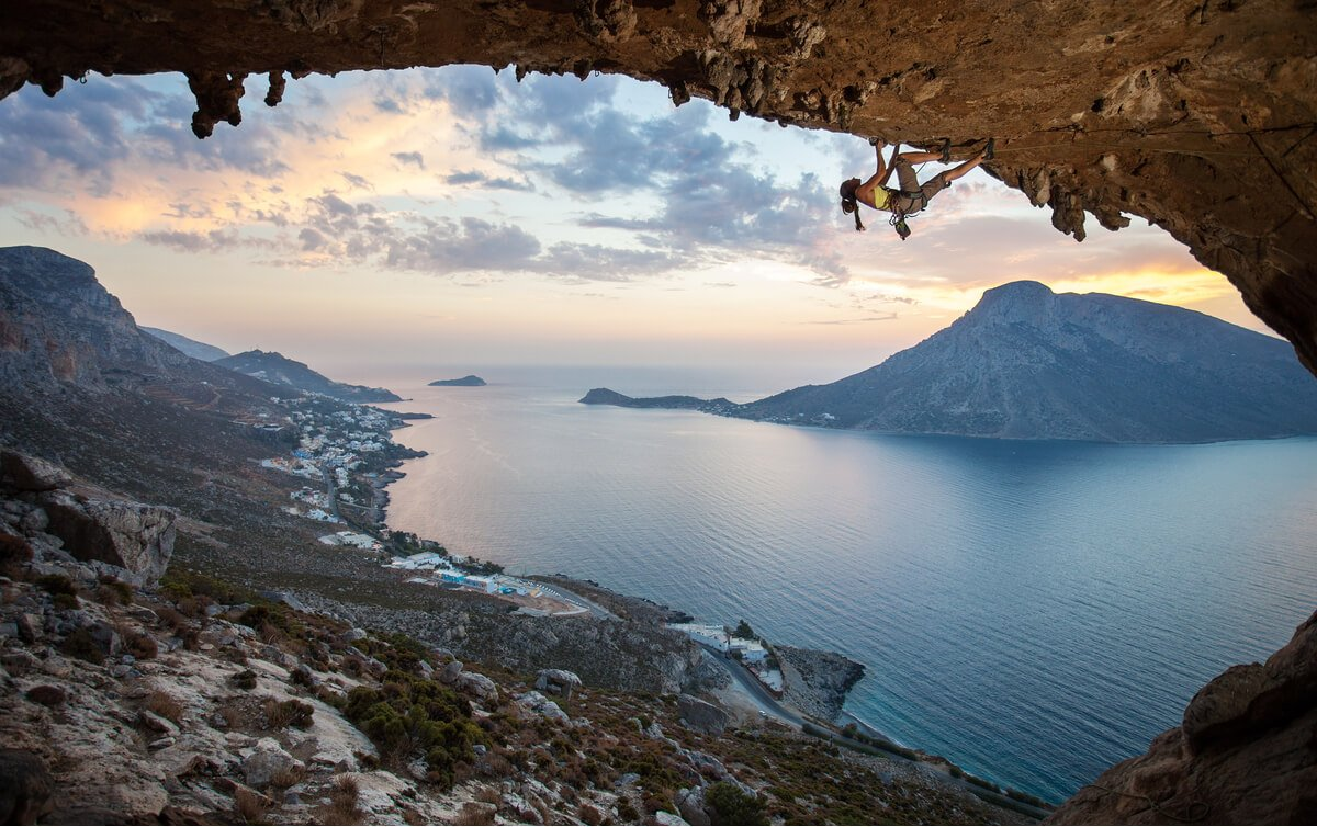 Rock climber on a wall on Kalymnos Island - adventure travel in Greece