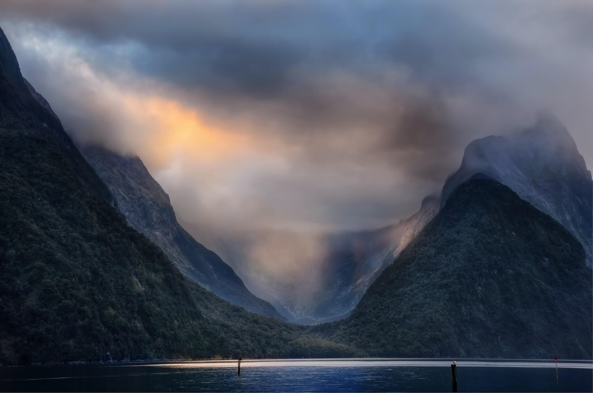 Kayaking in Milford Sound on a moody and overcast day