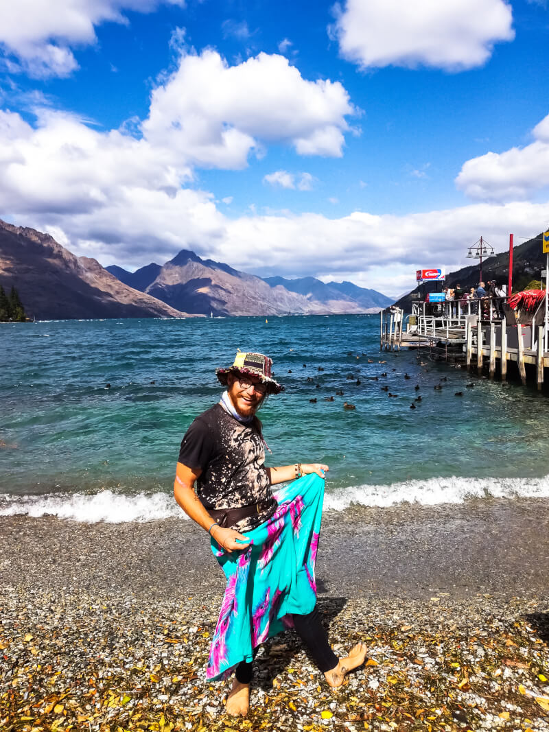 A budget backpacer in Queenstown shows off his second-hand shopping score at the waterfront
