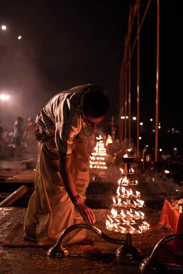 Hindu man on Diwali lights candles - famous festival in Sri Lanka