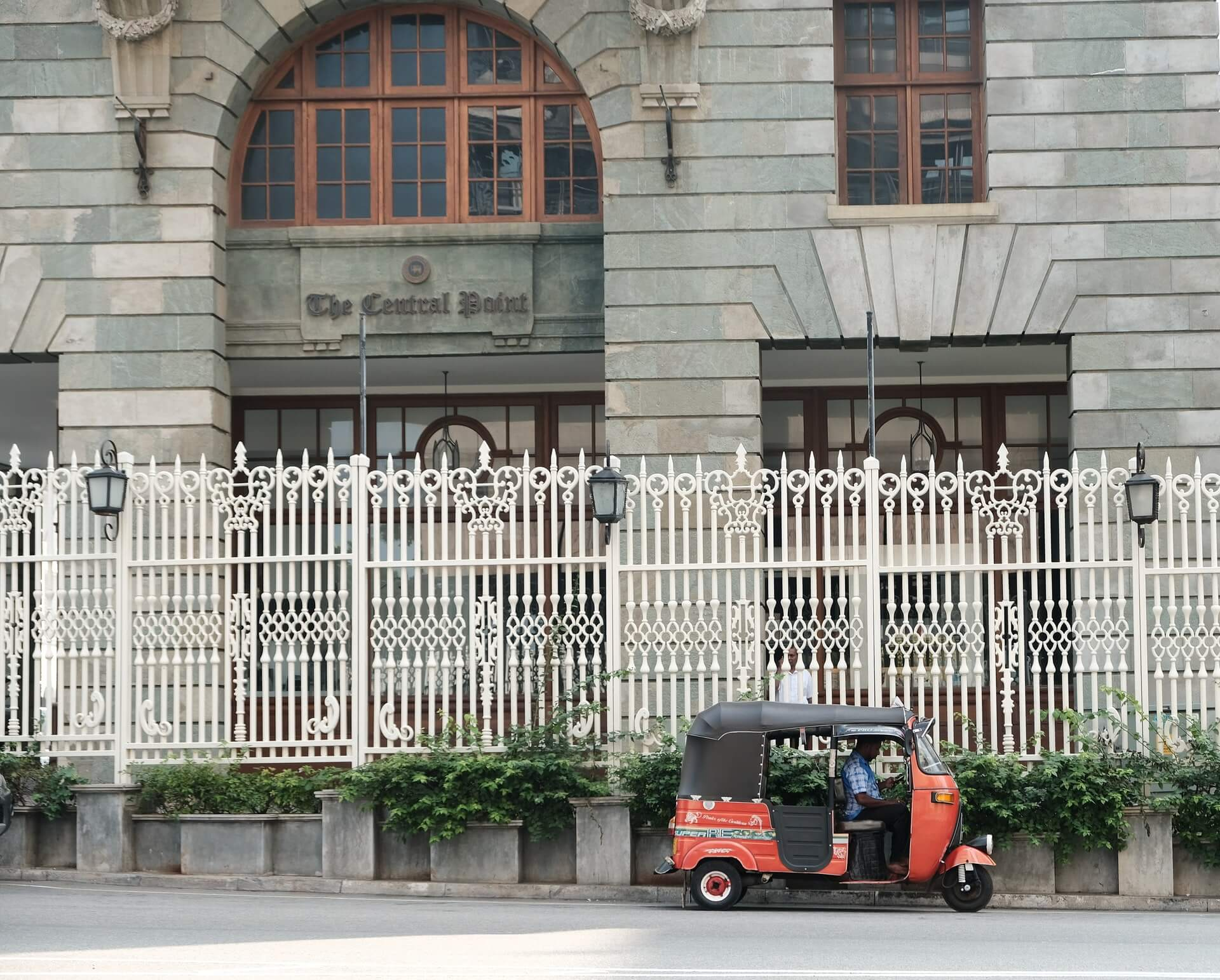 A tuk-tuk driver in Colombo waits for a tourist to get their Sri Lanka visa extension