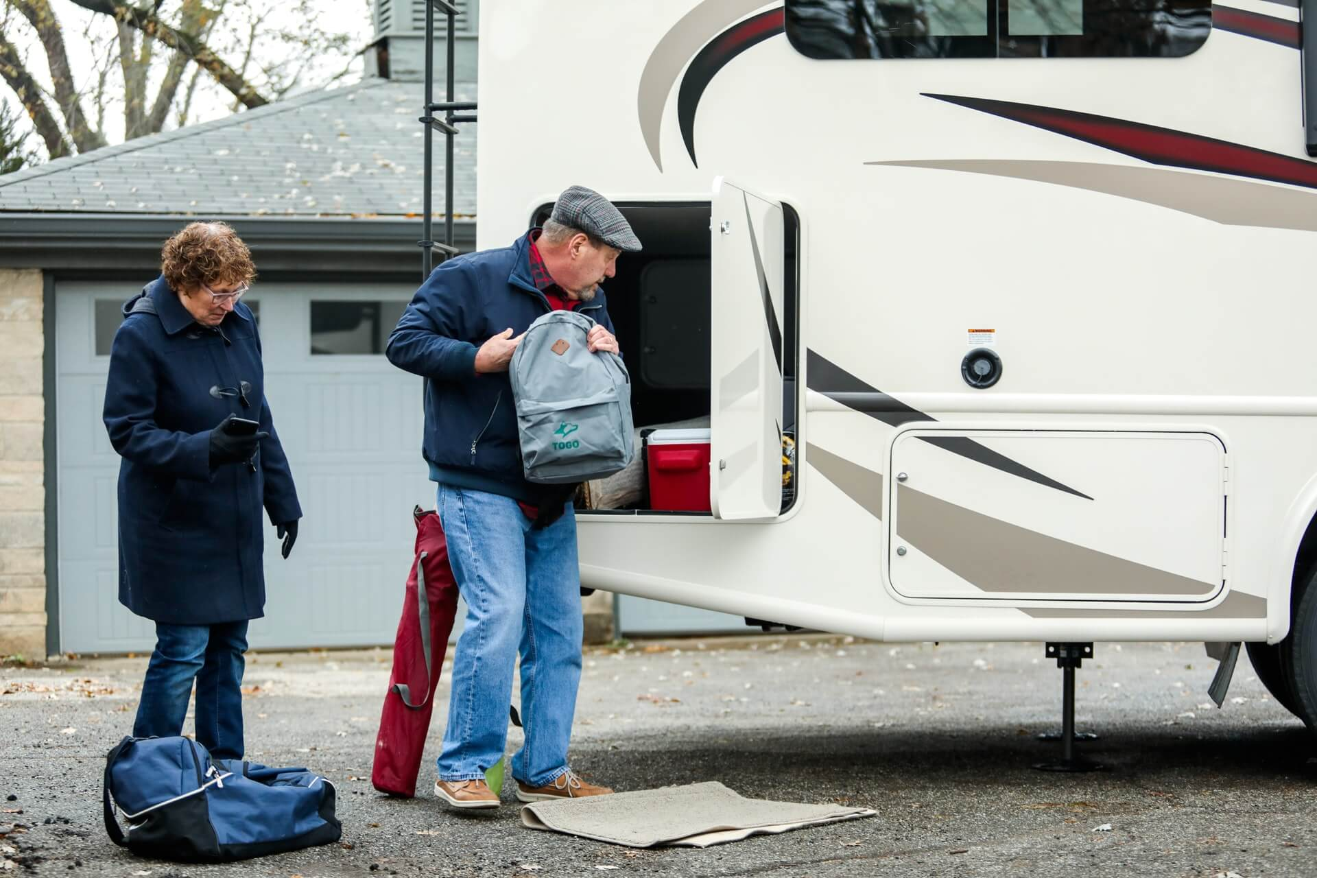 An old couple packing the RV for a road trip