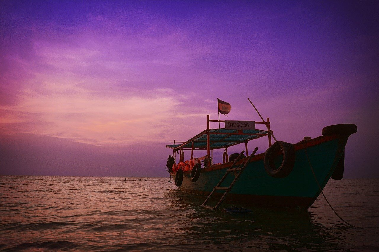 A sunset cruise on the river at Kampot - best tours in Cambodia