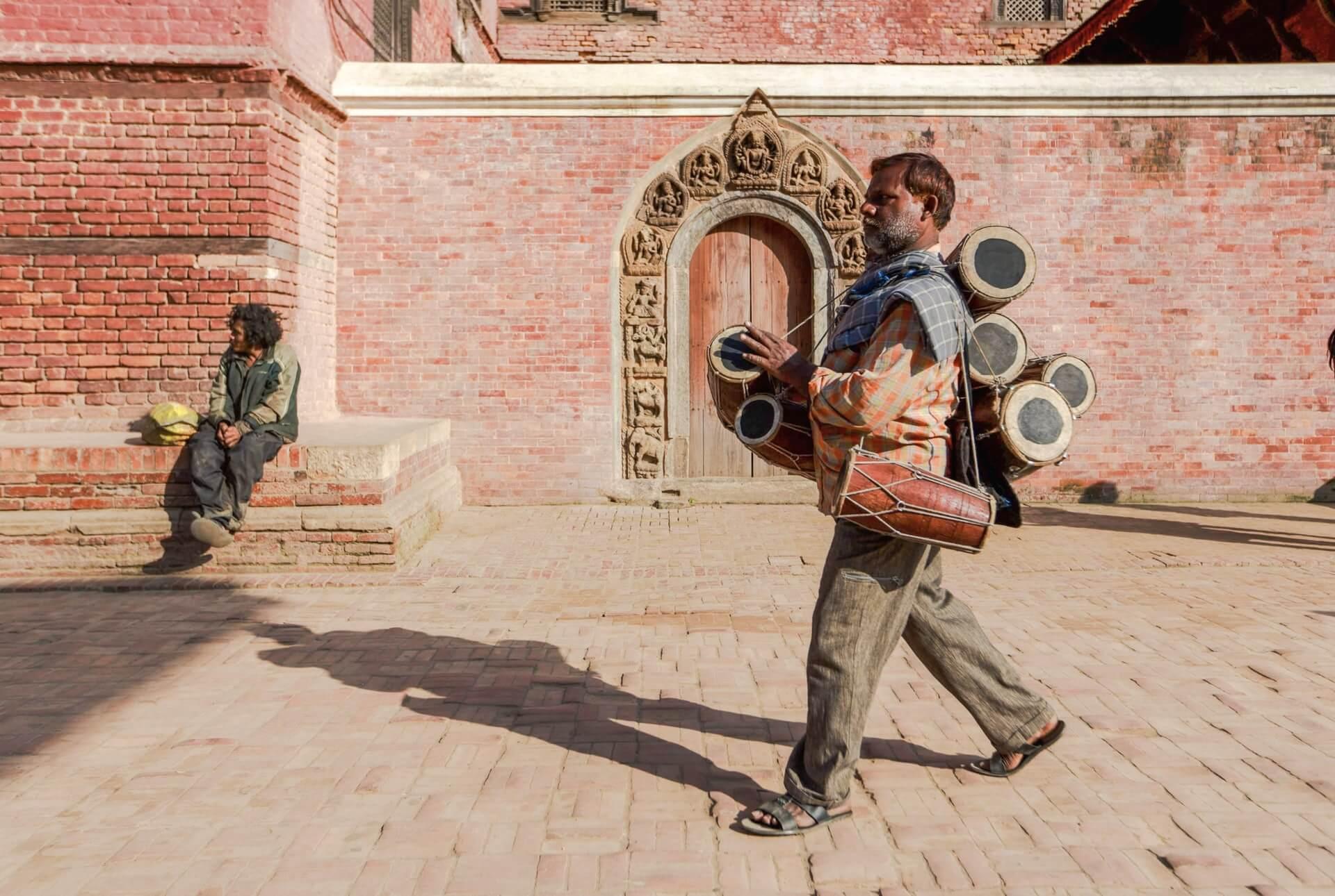 Drum merchant seen in a market while shopping in Kathmandu, Nepal