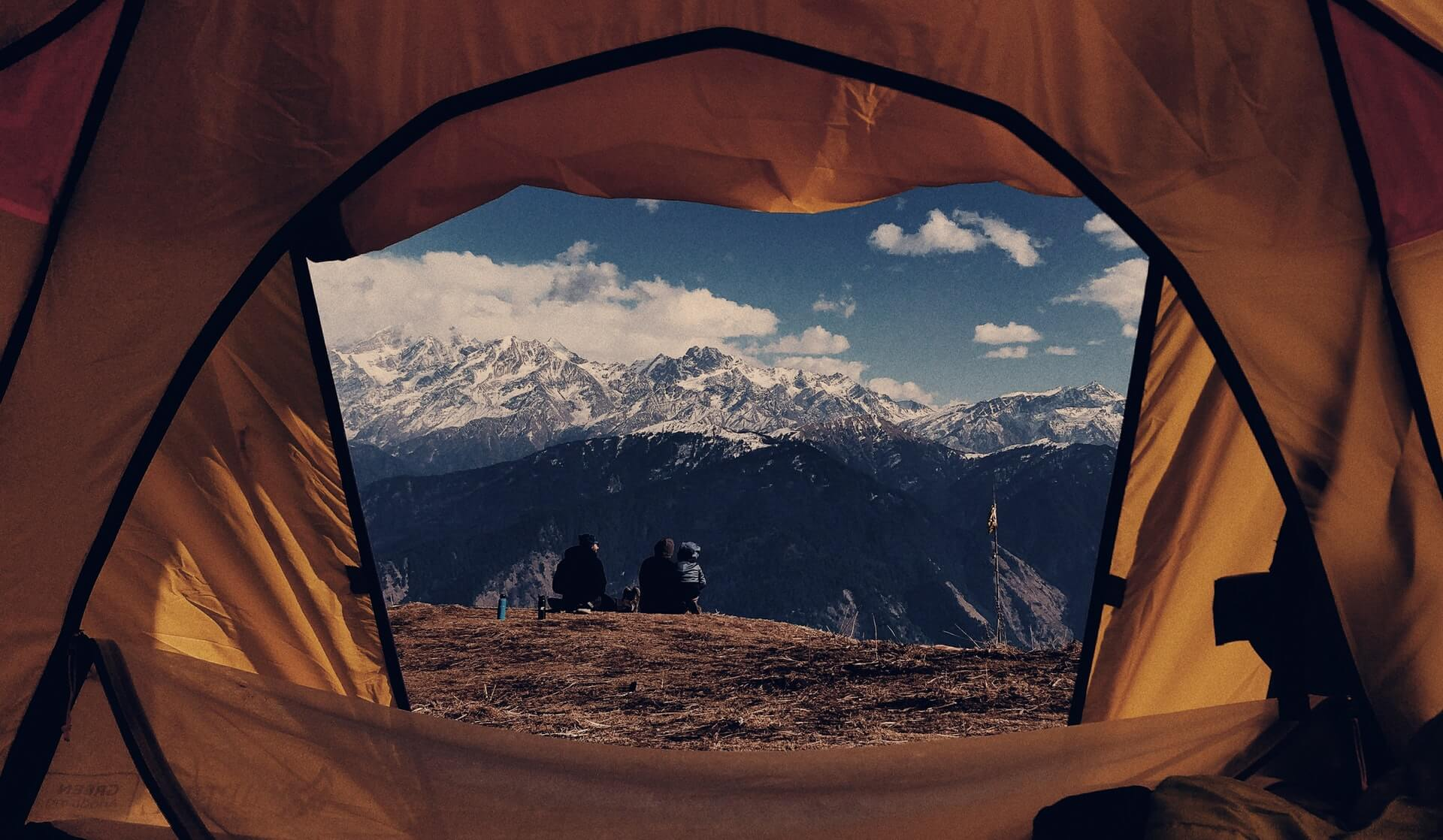 View through the tent flap while camping in the Himalayan mountains