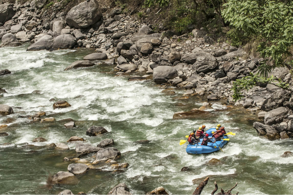 Tour group does whitewater rafting as an adventure activity in Nepal