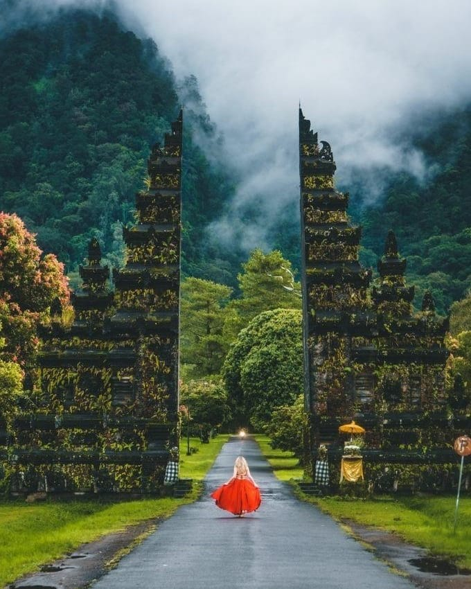 girl at gate in bali