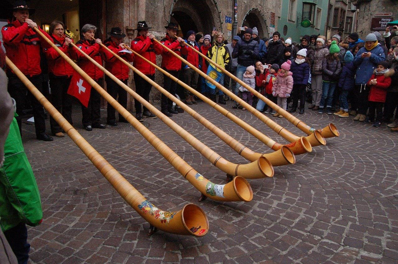 swiss culture people blowing horn