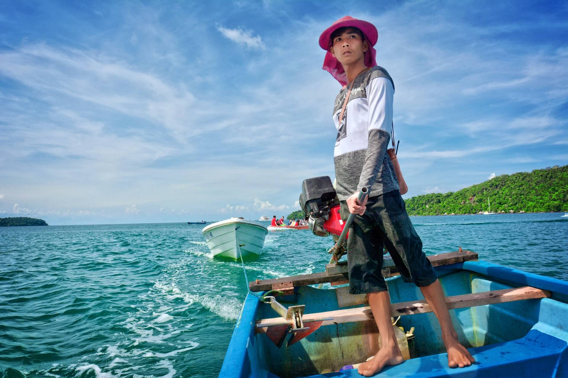 A Khmer boy ferries a backpacker in Cambodia to Koh Rong Sanloem