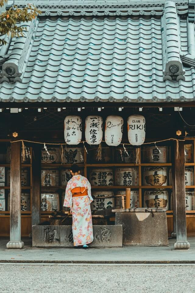 Woman at a Shinto shrine in Japan wearing traditional dress
