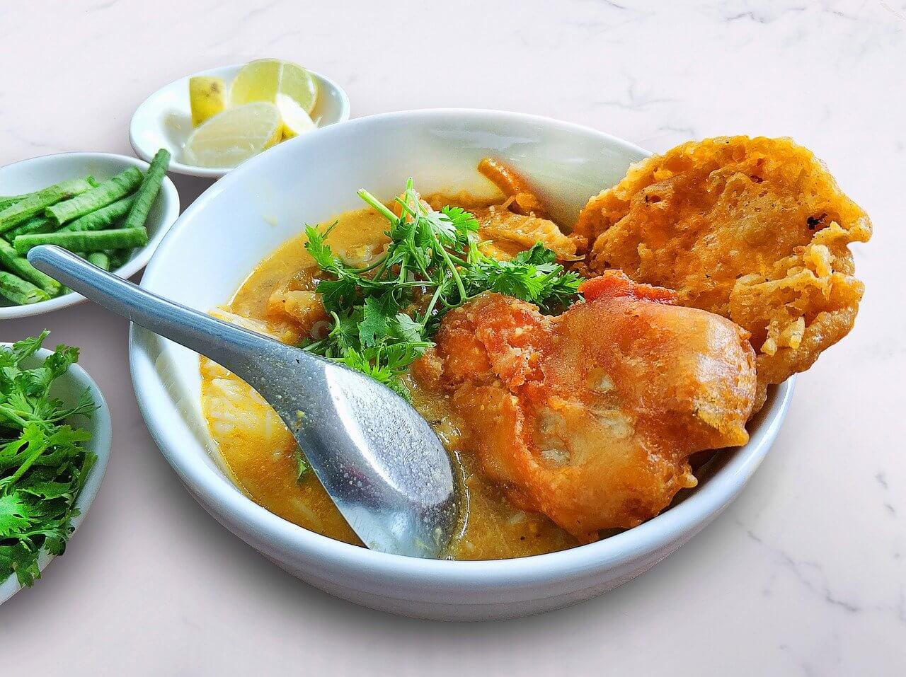 A mohinga soup with fried chicken - beloved national dish in Myanmar