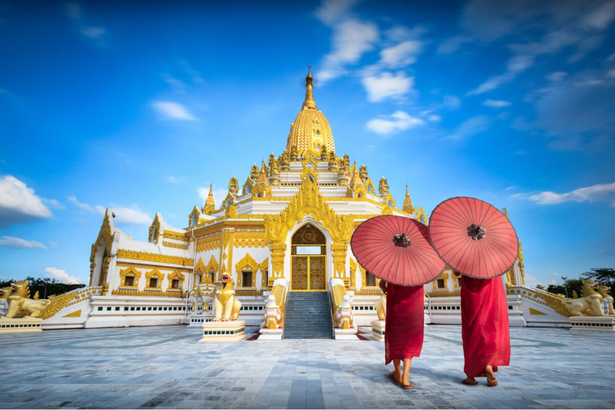 "Two women approach the Swe Taw Myat ""Buddha Tooth Relic"" pagoda in Yangon"