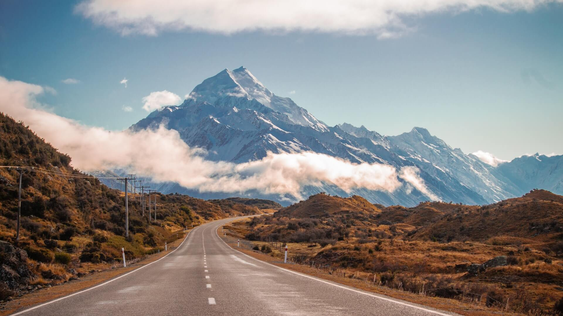 On a driving tour of New Zealand approaching Mount Cook by road