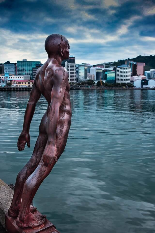 The leaning man 'Solace in the Wind' statue at the waterfront of Wellington harbour